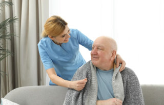 caregiver smiling to her patient