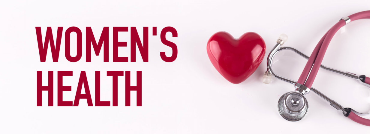 WOMEN'S HEALTH concept with stethoscope and heart shape
