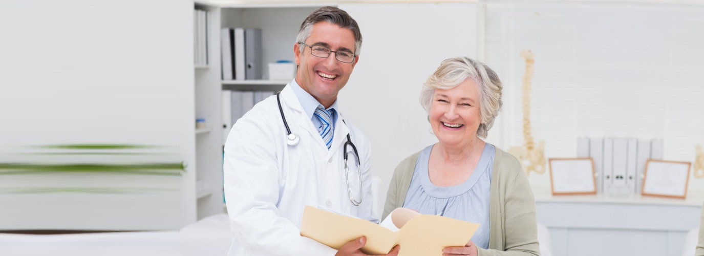 doctor along with his patient smiling